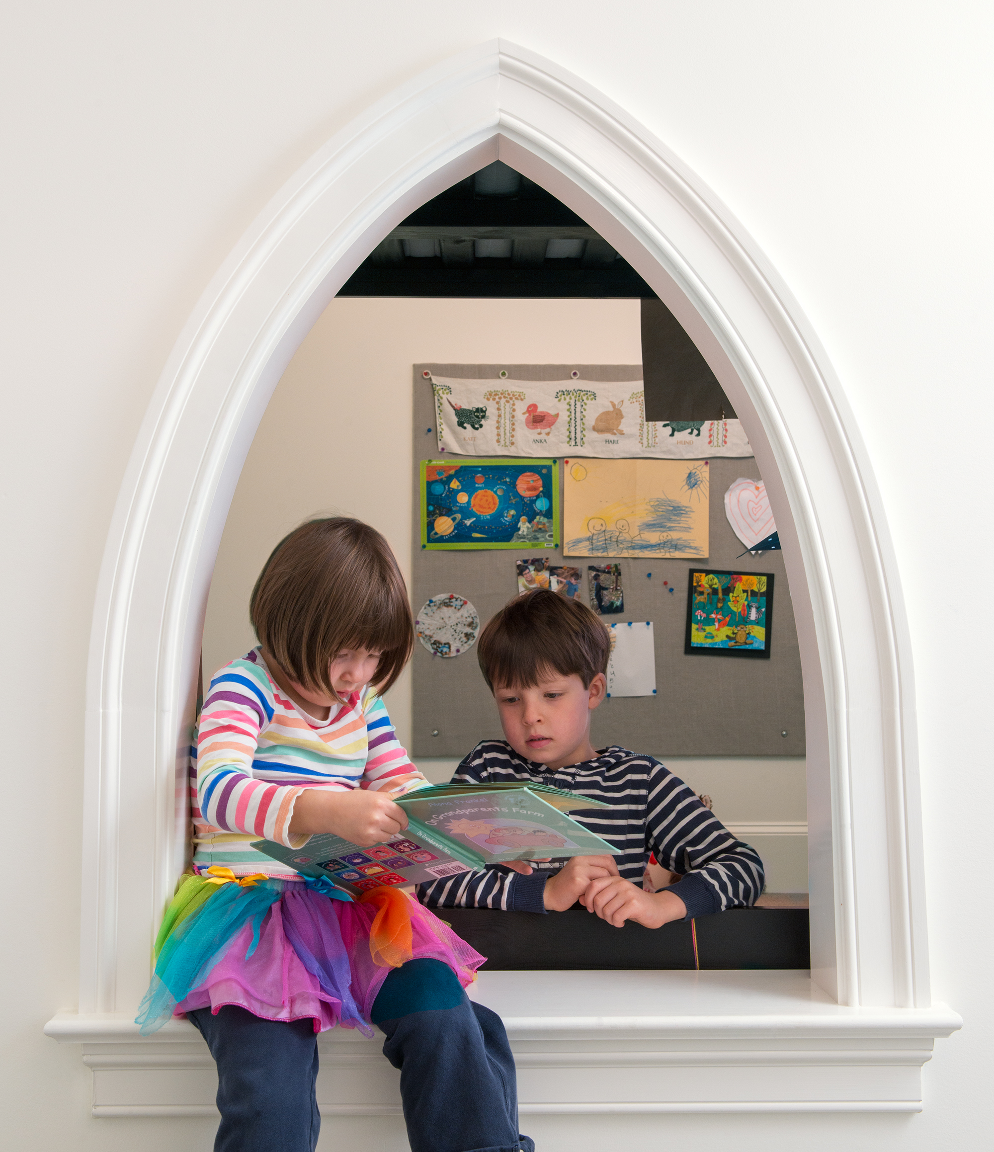 The kids' rooms are connected with a Gothic-arch opening.